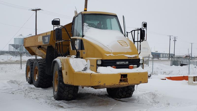 Used Caterpillar 730 rock truck for sale in Saskatoon