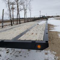 Used Doepker flatbed trailer for sale in MB