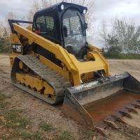 Track loader Cat 299D for sale or rent in Western Canada