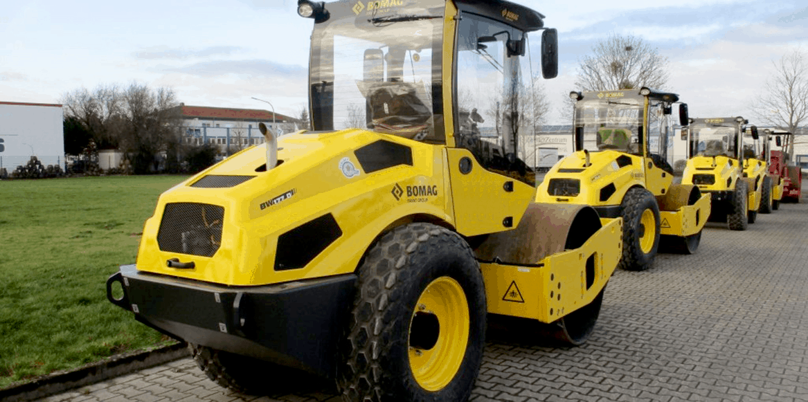 Bomag ride on compactor lined up in a row